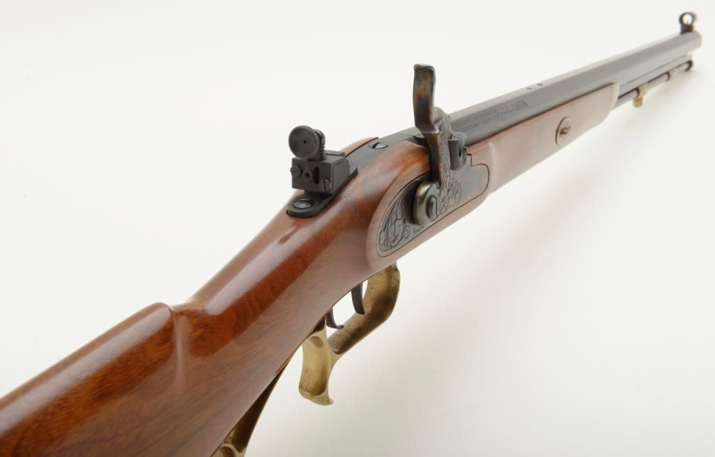 Thompson Center Arms company  54 caliber Hawkins style rifle with upgraded  adjustable sights in very