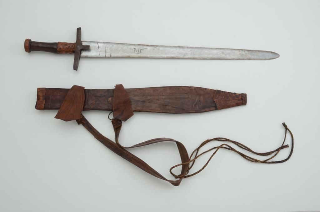 Authentic African tribal sword from ethnic weapons collector  Circa  1890-1930 with scabbard  Est : $