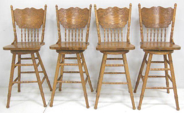 4 oak pressed back swivel bar stools