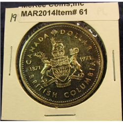 """61. 1871-1971 British Columbia, Canada Silver Prooflike Dollar. Lightly toned in 2"""" x2""""."""