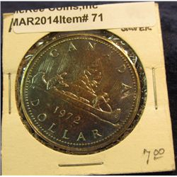 71. 1972  Voyageur  Canada Silver Prooflike Dollar. Toned. In 2  x2 .