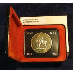 "93. 1873-1973 ""Mounted Police"" Canada Silver Prooflike Dollar. In original Royal Canadian Mint felt-"