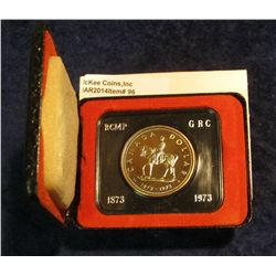 "96. 1873-1973 ""Mounted Police"" Canada Silver Prooflike Dollar. In original Royal Canadian Mint felt-"