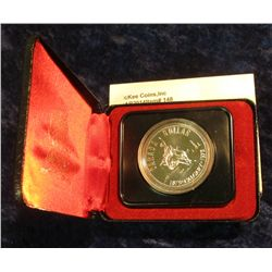 "148. 1875-1975 Calgary ""Bucking Bronc"" Canada Silver Prooflike Dollar. In original Royal Canadian Mi"