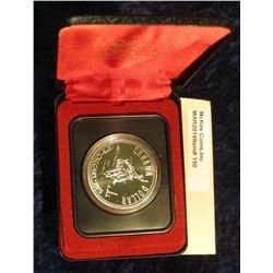 "150. 1875-1975 Calgary ""Bucking Bronc"" Canada Silver Prooflike Dollar. In original Royal Canadian Mi"