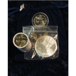 """311. Royal Blue Felt Bag """"World Reserve Certified Monetary Exchange"""" containing a half roll Iowa Sta"""