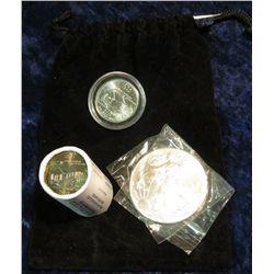 314. Black Felt Bag containing a half roll Iowa State Resident 2004 Quarters plus one encapsulated 2