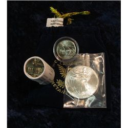 """324. Royal Blue Felt Bag """"World Reserve Certified Monetary Exchange"""" containing a half roll Iowa Sta"""