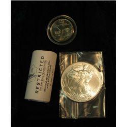 325. Black Felt Bag containing a half roll Iowa State Resident 2004 Quarters plus one encapsulated 2