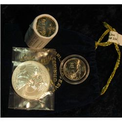 """334. Royal Blue Felt Bag """"World Reserve Certified Monetary Exchange"""" containing a half roll Iowa Sta"""