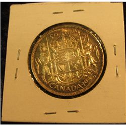 409. 1953 Canada Silver Half Dollar. Cameo. Gem BU. Rainbow toning.