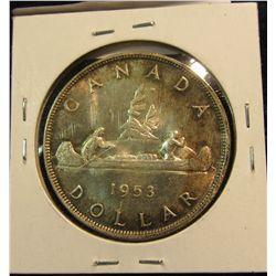 415. 1953 Canada Silver Dollar. Gem BU with attractive toning.
