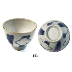 Small, blue-on-white Chinese porcelain teacup, K'angxi period, ex-Ullian.