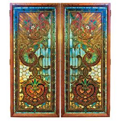 Stained glass doors (2), a magnificent multicolored matching pair w/blue glass predominating through