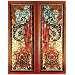 Stained glass doors, a magnificent multi-colored matching pair w/red glass predominating throughout,