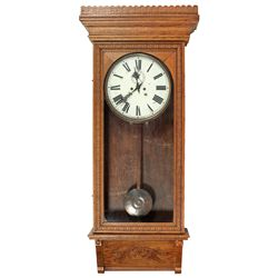 Wall clock, Waterbury Clock Co., ornate oak cabinet, Roman numerals on painted metal face w/second h