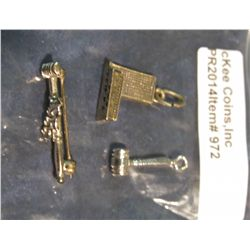 972.       2 charms and a pin – small gavel charm (not marked) UN BUILDING NYC (marked STERLING) and
