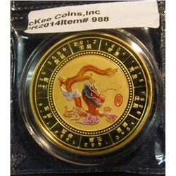 988.       Gold-plated Chinese Zodiac Year of the Dragon  medal, still sealed in original plastic pa