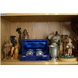 A selection of collectibles including wooden figures, a pair of boxed silver plate cups, framed prin