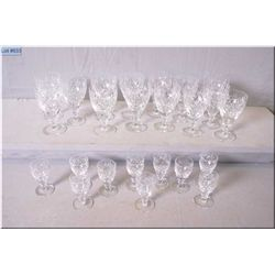 Selection of signed Webb and Corbett crystal glassware including fourteen wine glasses and ten sherr