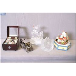 Selection of collectible including three musical ornaments, silver plate bank and a Christmas votive