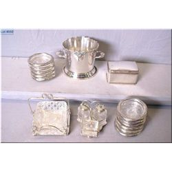 A selection of silver plate including hinged lidded box, ice bucket, small condiment galley, coaster