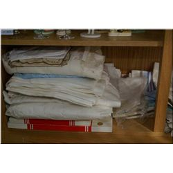 Selection of vintage linens including table clothes, napkins, runners, crochet and lace plus embroid