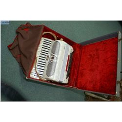 Vardes pearl coloured accordion in hard case