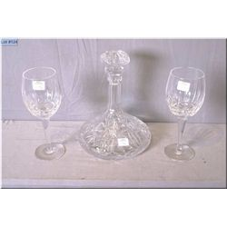 A crystal ship's decanter with two heavy crystal wine glasses