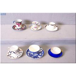 Six demitasse cups and saucers including Royal Nippon, Copeland, Coalport etc.