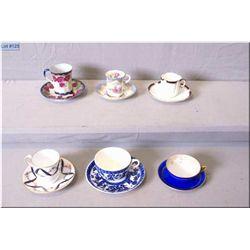 Six demitasse cups and saucers including Royal Nippon, Copeland, Coalport etc.