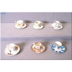 Six demi-tasse cups and saucers including Spode India tree, Royal Doulton etc.