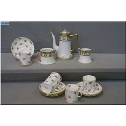 A hand painted Nippon teapot, cream and sugar plus five Cauldon demitasse cups and saucers