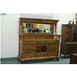 Large quarter cut oak antique sideboard with heavy claw feet, twist and carved columns, bevelled mir