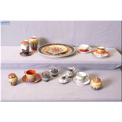 Collection of Japanese porcelain including plates, cups, saucers, lidded pots, salt and pepper shake