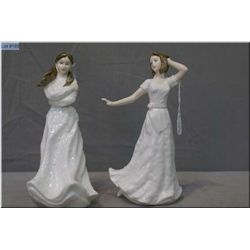 "Two small Royal Doulton figurines including ""Charmed"" HN4445 and ""Embrace"" HN6258"