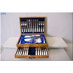Oak canteen containing silver plate fish and flatware set including settings for six of fish knives,