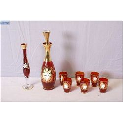 A Murano ruby glass vase, decanter and six glasses all with gilt decoration and hand enamelled flowe