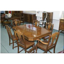 Refractory style walnut dining table with jack knife leaf and six chairs including one carver made b