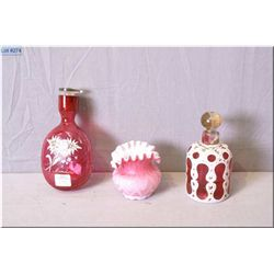 A hand enamelled cranberry crackle glass flask, a pink cased ruffled and quilted glass dish and a ca