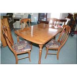 Modern dining table with insert leaf and four chairs