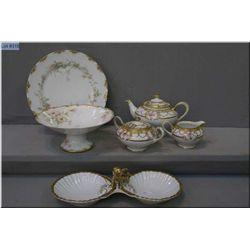 Vintage Noritake tea set including tea pot, lidded sugar and cream jug with hand enamlling and gilt