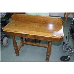 A quarter cut oak console table with backboard
