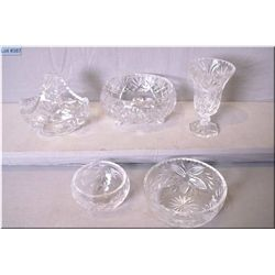 Five pieces of crystal including bowls, basket and a vase