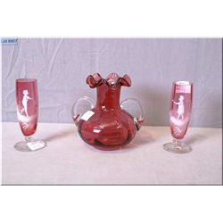 Three antique pieces of Mary Gregory glass including ruffled etched and double handled cranberry vas