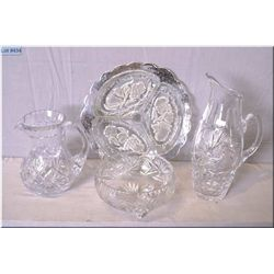 Four pieces of crystal including two jugs, silver overlay divided dish and a footed bowl