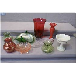 A selection of vintage and collectible glass including ruffled bud vase, cranberry, art glass etc.