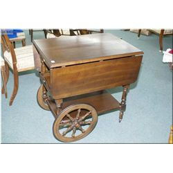 Drop leaf tea wagon with single drawer and slide out serving tray