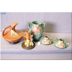Five pieces of Roseville Pottery including Clematis candle holders and double handled vases, a candl