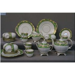A vintage china tea service including footed teapot, cream jug, sixteen tea cups and twelve saucers,